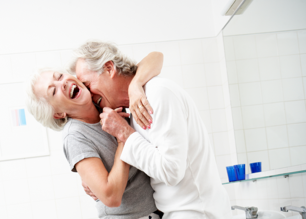 Loving-senior-couple-in-pajamas-dancing-in-a-bathroom-000021601435_Medium (1)